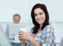 Glowing businesswoman drinking a coffee Stock Photography