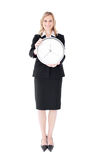 Glowing businesswoman holding a clock Royalty Free Stock Photography