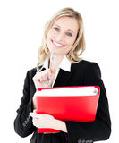 Glowing businesswoman holding a folder and smiling Stock Photo