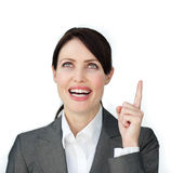 Glowing businesswoman pointing at a copyspace Stock Image