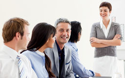 Glowing businesswoman presenting to her team Stock Images