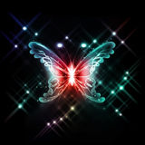 Glowing butterfly. Abstract glowing butterfly on a dark background Royalty Free Stock Images