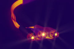 Glowing cable plugs Stock Image