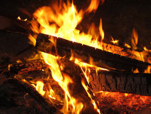 A glowing camp fire on a camping night Royalty Free Stock Photos