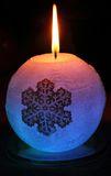 Glowing candle with a diode and snowflake Stock Photos