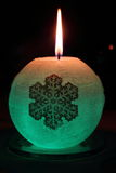 Glowing candle with a diode and snowflake Stock Images