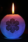 Glowing candle with a diode and snowflake. Lights up in the dark Royalty Free Stock Images