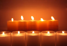 Glowing candles. Two lines of glowing candles Royalty Free Stock Photos