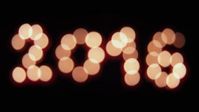Glowing 2016. Glowing candles 2016 on black background. loopable stock footage