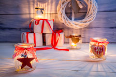 Glowing candles and gifts for Christmas Royalty Free Stock Photos