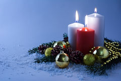 Glowing candles in snow Stock Images