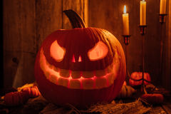 Glowing Carved Pumpkin or jack-o-lantern Royalty Free Stock Image