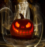 Glowing Carved Pumpkin or Jack-O-Lantern with Lights Stock Photo