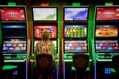 Glowing casino slot machine. In the gambling zone stock image