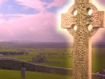 Glowing Celtic Cross. A celtic cross glowing with an inner spiritual light Stock Photos