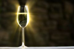 Glowing champagne glass. Royalty Free Stock Photography