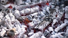 Glowing charcoal in barbecue grill stock video