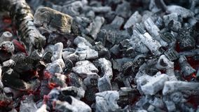Glowing charcoal in barbecue grill stock footage