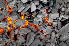 Glowing charcoal for bbq, gray and red background Stock Photos