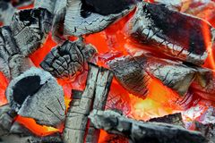 Glowing charcoal and flame in BBQ Royalty Free Stock Photography