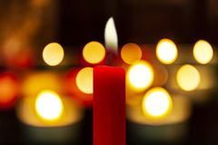 Glowing christmas candles in the dark royalty free stock image