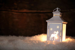 Glowing Christmas lantern shining in the night royalty free stock photos