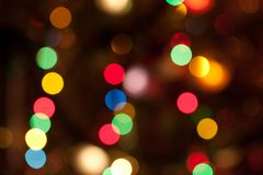 Glowing Christmas lights. Glowing bright colourful christmas lights abstract background Royalty Free Stock Photography