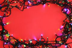 Glowing Christmas lights on color background top view. Glowing Christmas lights on color background, top view Stock Photo