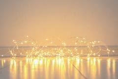 Glowing Christmas lights. On floor Stock Photos