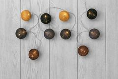 Glowing Christmas lights on wooden background,. Top view Royalty Free Stock Photos