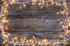 Glowing Christmas lights on wooden background stock photo