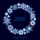 Glowing 2016 christmas new year background. Diamond crystal snowflakes round frame on dark blue. Winter holiday design Stock Photo