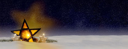Glowing Christmas star by night with snow Stock Photography