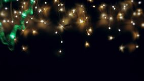 Glowing Christmas tree against the night sky. Abstraction of garlands.