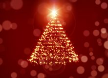 Glowing Christmas Tree Over Red Background Stock Photo