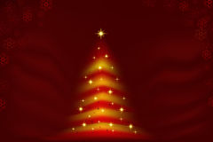Glowing Christmas tree red and gold Royalty Free Stock Photography