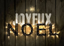 Glowing Christmas word NOEL made of led lights Stock Photos