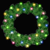Glowing Christmas wreath Stock Images
