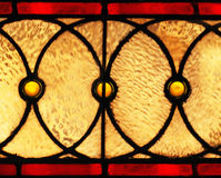 Glowing Circles. A set of glowing golden circles on a stained glass window Royalty Free Stock Photos