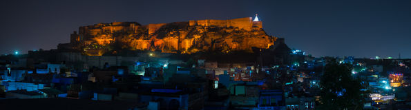 Glowing cityscape at Jodhpur at dusk. The majestic fort perched on top dominating the blue town. Scenic travel destination and fam Royalty Free Stock Photo