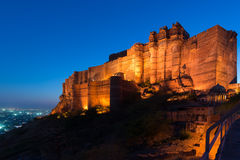 Glowing cityscape at Jodhpur at dusk. The majestic fort perched on top dominating the blue town. Scenic travel destination and fam Stock Images