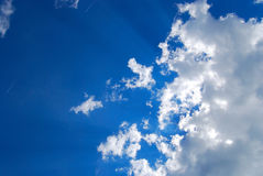 Glowing cloudscape with sunbeams Stock Photos