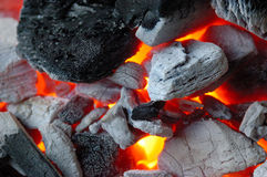 Glowing coal. Hot glowing barbeque coal macro stock photos