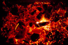 Glowing coals. And fire background texture Royalty Free Stock Image