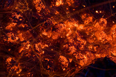 Glowing coals. And tracks of flying sparks royalty free stock image