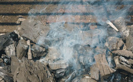 Glowing coals in a barbeque coal fire smoke Royalty Free Stock Photos
