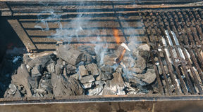 Glowing coals in a barbeque coal fire smoke Stock Images