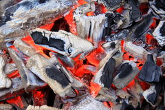 Glowing coals. Hot embers and burned pieces of wood Stock Photography