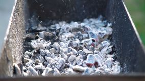 Glowing Coals with Smoke in the Brazier. Glowing Coals with Smoke and Flying Small Pieces of Ash in the Brazier after Preparing Meat on Charcoal Grill. Leisure stock video