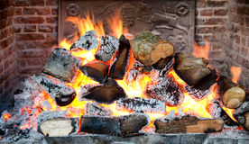 Glowing coals in a wood fire Royalty Free Stock Photo